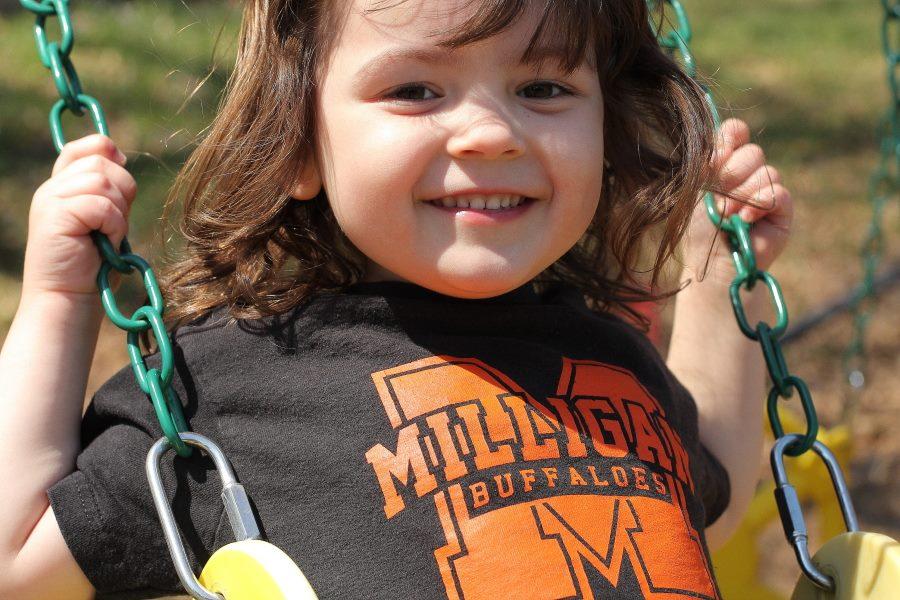 Hannah on her swing set Swing, swing!
