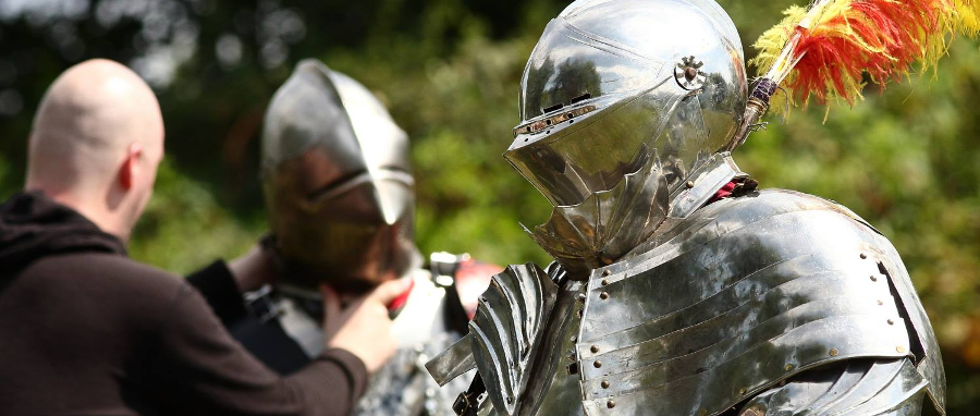 Lords of Chivalry in full armor, preparing for the joust.